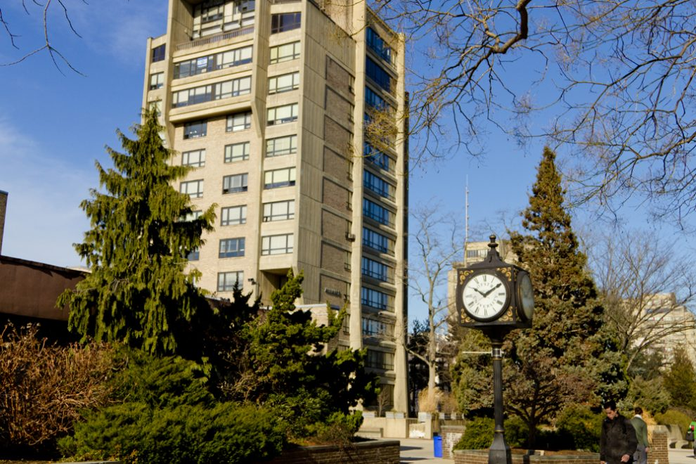 A residence hall and a four-way clock on north campus.