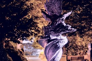 One of many Hofstra statues captured after dark.
