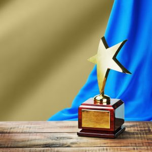 Stock photo of an award trophy featuring a star
