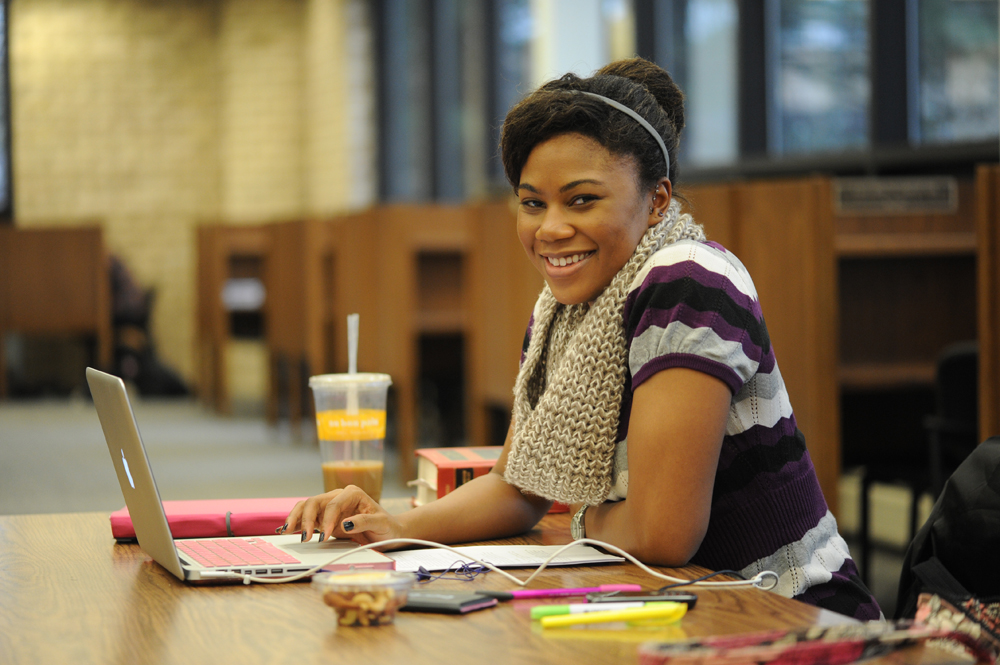 A Hofstra Law student in the library.
