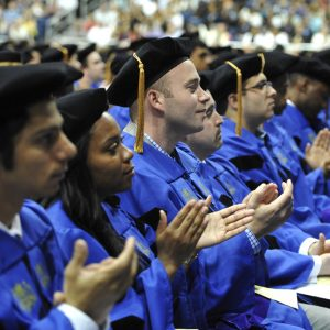 Students applauding the class of 2013 at the graduation ceremony.