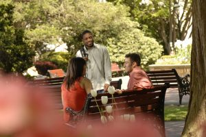 Students talking outside between classes.