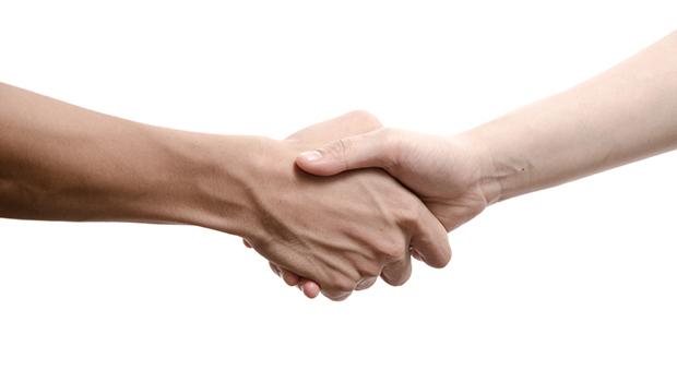 A congratulatory handshake.