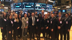 Group photo of Hofstra Business Law Society students on a tour of the New York Stock Exchange (NYSE) given by Gregg Krowitz, vice president of global listings
