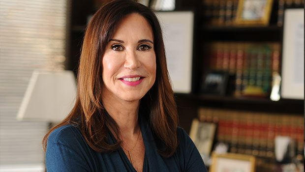 Official photo of Judge A. Gail Prudenti, Dean of the Maurice A. Deane School of Law at Hofstra, in her office