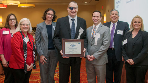 Photo of Gitenstein Institute senior fellow Adam D. Kahn '13 (third from right) accepting the the 2017 IPRO Quality Award on behalf of the Conversations: Health and Treatment (CHAT) project, a partnership between the Gitenstein Institute for Health Law and Policy at Hofstra Law and Northwell Health