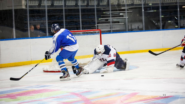 Photo of Hofstra Law alumnus Jason Kurland '00 playing goalie for the U.S. Masters men's ice hockey team at the 20th World Maccabiah Games in Jerusalem in July 2017