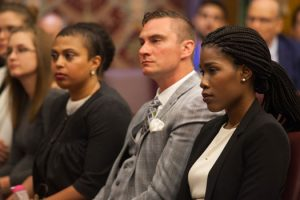 Photo of recent Hofstra Law graduate Chanya Sainvilus '17 (at right) seated with other top 10 entrants in the Philip R. Shawe Scholarship Competition at the final round in the historic landmark courtroom in Brooklyn Borough Hall on July 20, 2017