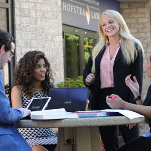 Four Hofstra Law Students Talking on the Plaza Outside the Law School Building