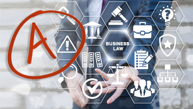 """An image depicting excellence in business law: the torso of a person in business attire with symbols associated with business law and a large letter """"A"""" in a circle"""