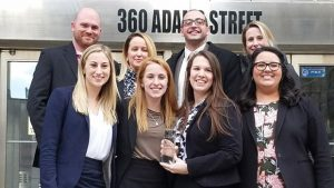 Photo of the first-place Hofstra Law Mock Trial Team and coaches at the New York Regional of the American Association for Justice 2018 Student Trial Advocacy Competition