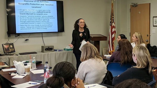 Photo of Hofstra Law student Safia Fasah, Class of 2018, a member of the Deportation Defense Clinic, presenting at a workshop on immigrants' legal rights