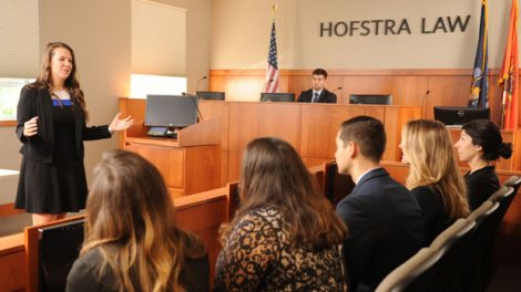 Photo of students in the Weitz & Luxenberg Trial Courtroom at Hofstra Law, which is updated with the latest advancements in courtroom technology