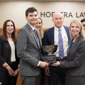 Photo of the trophy presentation at the inaugural Medical-Legal Trial Competition, won by the team from William & Mary Law School