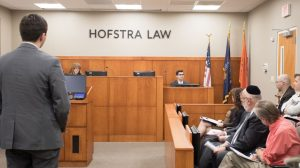 Photo of the final round at the inaugural Medical-Legal Trial Competition, held in Hofstra Law's Weitz & Luxenberg Trial Courtroom