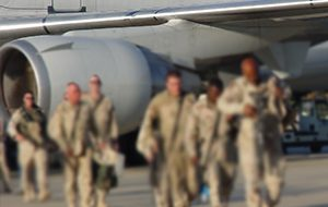 Photo od miltary getting off of an airplane.