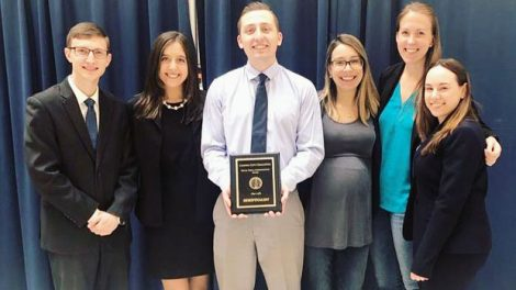 Photo of Hofstra Law trial advocacy team of Michael LaPinta 1L, Gabriella Klein 2L, Matthew Perticone 1L, and Dana Suekoff 2L for the 2019 Capitol City Challenge and their coaches, Laura Dorfman '12 and Kaitlyn Flynn '14, with their semifinalist plaque