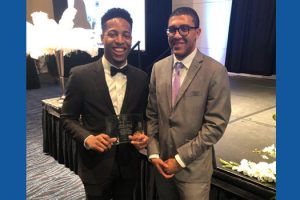 Photo of Hofstra Law students Olivier Labossiere 3L and Jordon Flanigan 1L with the second-place award at the 2019 Nelson Mandela International Negotiations Competition