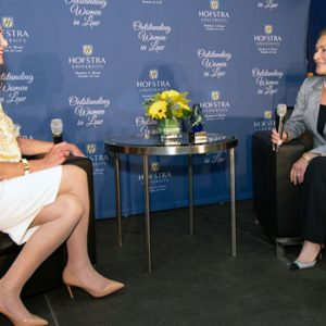 """Photo of Judge Gail Prudenti, dean of Hofstra Law, in conversation with Judge Judith Sheindlin, former Manhattan Family Court Supervising Judge and star of """"Judge Judy"""""""