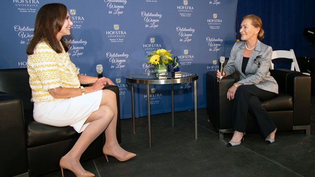 "Photo of Judge Gail Prudenti, dean of Hofstra Law, in conversation with Judge Judith Sheindlin, former Manhattan Family Court Supervising Judge and star of ""Judge Judy"""