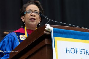 Photo of Hon. Loretta Lynch, former U.S. attorney general, delivering the commencement address at the 2019 Maurice A. Deane School of law graduation ceremony on May 20