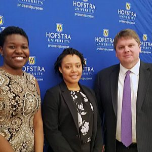Photo of Hofstra Law rising third-year student Vanessa Wilcox (center), recipient of the inaugural Harris Beach Diversity Scholarship, with Sandy Milord and Tom Garry of Harris Beach of Harris Beach at Hofstra University's annual scholarship luncheon on March 27, 2019