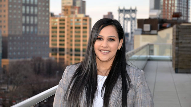 Photo of Hofstra Law alumna Mariel Colon Miro '17 on a rooftop in Manhattan, NY