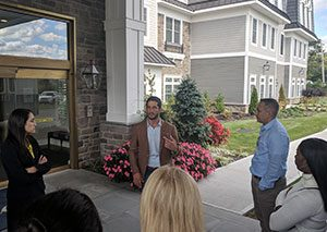 Photo of Professor Ashira Ostrow, director of the Breslin Center for Real Estate Studies, and students in the Real Estate Development Seminar course visiting a local developed property