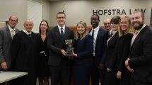 Photo of (left to right) Jared Rosenblatt; Judge Arthur Diamond '78; Judge Gail Prudenti, Dean; and (fourth from right) Gino Farina, MD, with the team from Campbell Law School, winners of the 2019 National Medical-Legal Trial Competition